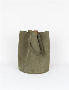 creatures of comfort bucket bag in large olive.