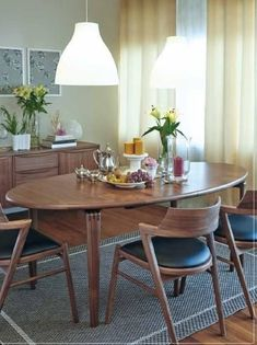 Solid Walnut Dining Chairs And Oval Dining Table With One Extension Also  Available In Teak.