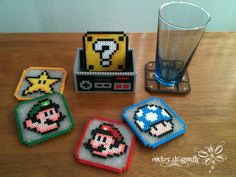 Super Mario Bros. Coasters made from perler beads, but could be done with plastic canvas stitching too