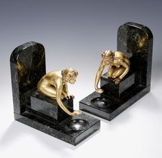 Continental, circa 1930, A pair of Art Deco gilt metal bookends,