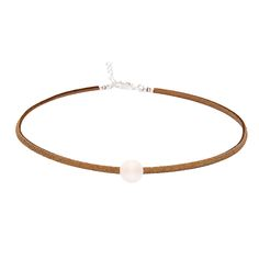 Our Brown Suede Pearl Choker is part of our Far East Pearl Collection – All…