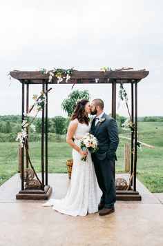 Rustic + elegant ceremony arch idea - outdoor ceremony arch - brown wooden arch with greenery + flowers {Lauren Love Photography}