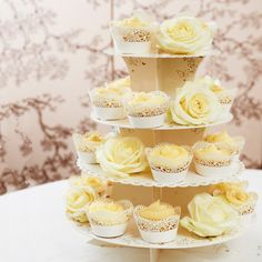 Butterfly Cupcake Stand | #exclusivelyweddings | #yellowwedding I like the idea of adding roses to the stand.