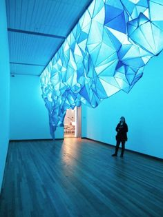 gorgeous iceberg sculpture made of tissue paper and staples by gabby o'connor.