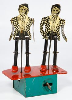 "Lot 352: Black Americana ""Jigger"" Dancing Minstrels Tin Wind-Up Toy; 1937, possibly made by Buffalo Toy and Tool Works"