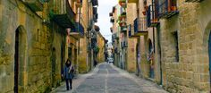 Walk along centry old alleyways on the Camino de Santiago path. #CWAdventure #SelfGuided #Walking #Spain #CaminodeSantiago #Culture #History #Pilgrim #Path #Travel #Experience #Trail