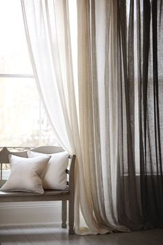 Ombre Sheers - Just buy one set of sheers in each color and hang your rod a little higher and wider than normal. The darkest sheer will help hide the edge of the window.