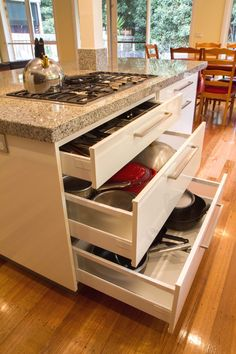 Contemporary kitchen with 3 drawer stack. Perfectly located under cooktop for easy access to utensils, pots and pans. www.thekitchendesigncentre.com.au