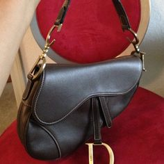 Authentic Dior saddle leather bag  This pre loved Dior saddle bag is 100% authentic. In good shape. Some scratches throughout the leather from wear.  Clean inside. Comes with dustbag. No trades Dior Bags