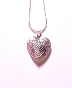 Silver heart locket with sterling silver heart
