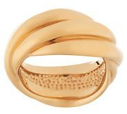 I adore this ring! It reminds me of the famous Cartier intertwined bands....I really like that the gold is a little matte, not super shiny. Plus, the price, at roughly $220, is much easier on the pocketbook that the stunning Cartier ring!