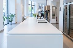 this island by Poggenpohl with Dekton Zenith countertops is ideal for a minimalist design