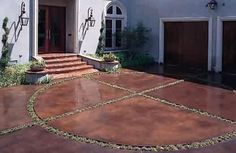 Front Door & Garage: Concrete stained drive with plantings help scale down the paved space.