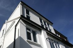 A rendered Hip to Gable conversion with flat roof dormer: building the gable off the outside wall plate created a three-storey town house effect. Loft Conversions, The Gables, Flat Roof, Surrey, Plates On Wall, Townhouse, Mansions, House Styles, Building