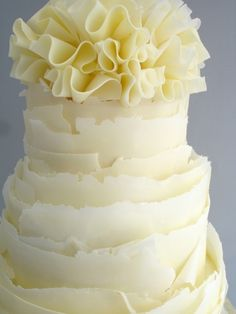 This playful lemon ruffle wedding cake adds a tasty touch of white chocolate ruffles and wraps made with pure couverture chocolate. White Wedding Cakes, Beautiful Wedding Cakes, Beautiful Cakes, Amazing Cakes, White Chocolate Cake, Modeling Chocolate, Chocolate Cakes, Chocolate Wrapping, Ruffle Cake