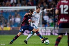 Gonzalo Escalante (l) of SD Eibar competes for the ball with Sergio Ramos of Real Madrid during the La Liga 2017-18 match between Real Madrid and SD Eibar at Estadio Santiago Bernabeu on 22 October 2017 in Madrid, Spain.