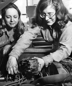"Margo Geisler, left, assists her daughter Debi, 22, at tuning an engine at the Auto Tuning Center in Omaha. Margo is the president of the two-location service center and Debi is the vice-president. According to an April 1976 World-Herald article, some customers were a bit leery of a female mechanic, but most overcame their concerns. ""If the customers are especially anxious they were allowed to watch Debi work. 'Only two customers have driven out without letting me do the tuneup — both were men,' she said."" THE WORLD-HERALD"