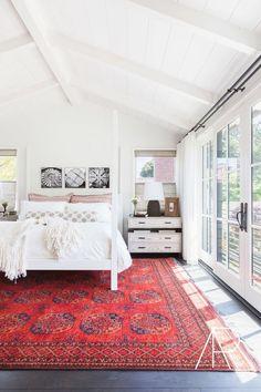 White bedroom - neutral linens - window coverings (shades & drapes) - dark hardware - simple, minimal accessories - bright, bold rug - ©️️AlyssaRosenheck2016 with Jennifer Robin Interiors - Rue Magazine