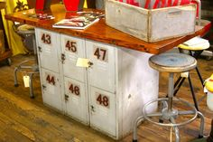 Salvaged & Repurposed: Vintage Lockers - add an old door to top to form island or desk - also works with old file cabinets as base!