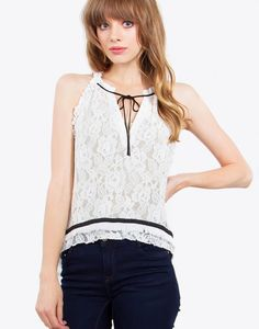 – Lace ruffle detail sleeveless top – Fringe trim hem – High low hem – Neck tie detail – Color: White  Size + Fit – Model is wearing size S – Measurements taken from size S – Length: 23″ – Chest: 36″