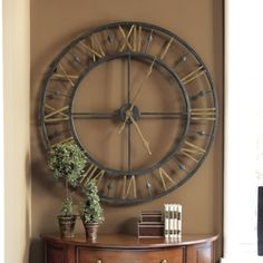 """$179 metal frame, aged iron, antq gold finish ,36"""" diam wall clock.   I want this"""