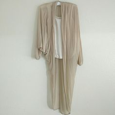 "Long Cardigan You dress up or down with this cream color cardigan. The sleeves fit loose for those summer nights. End of the sleeves are capped. The back hangs in the shape of an ""U"".  100% lyocell Guess Sweaters Cardigans"