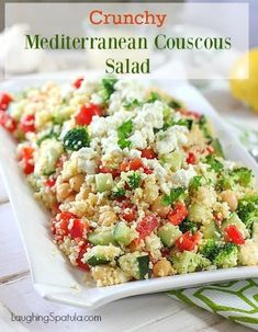 This crunchy fresh and easy to make Mediterranean Couscous Salad is such a great change up from your everyday salad!  #couscous #easysalad #garbanzo #greeksalad via @laughingspatula