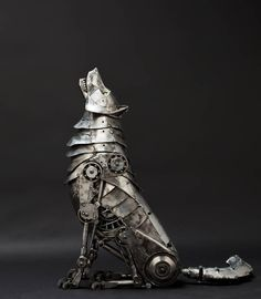 """""""Mechanical Articulated Wolf Sculpture"""" by Salt Lake City-based Andrew Chase  This mechanical metal wolf was created from used transmission parts, twenty gauge sheet steel, ¼ inch rod, recycled pipe and tube, and two cats eye marbles.  Plus, it would look great sitting next to my front door."""