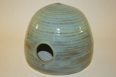 A handmade ceramic bird house by Katie Austin Ceramics.  www.katieaustinceramics.com