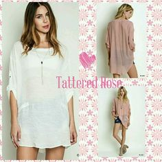 """""""Sanza"""" High Collard Shift Tunic Just a great tunic that goes with everything! This semi sheer oversized high collar shift tunic has rolled up sleeves with a button closure. Available in white only! ??Sewn with love. Tops Tunics"""