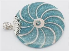 An ordinary shell pops when paired with a beautiful color of resin.  Check out the different shell and resin options at http://www.silverbybali.com/apps/webstore/products/category/993949