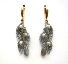 Earrings with labradorstone, Swarovski pearls and leaves of Japanies beads. Size: 6cm.