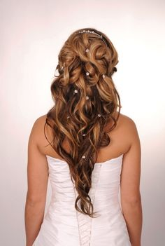 Bride with long curly hair, tiara and hair accessories #wedding #hairdo    Contact www.Signature-Event.com to assist in planning your special #wedding details. #Planner #Coordinator #Destination