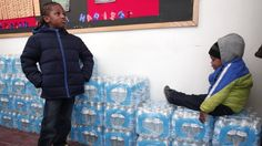 Residents waiting for bottled water in Flint