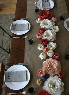 love the flowers as a table runner- it could be a cute idea to make a bunch of different table themes (some with burlap and lace, some with burlap and flowers, etc.)
