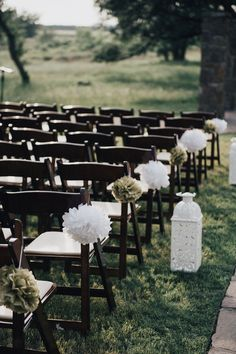 Outdoor ceremony decor idea - white lanterns and green + white paper pomanders aisle markers {Nine Photography}