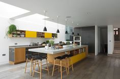 Uncommon Projects Bespoke Kitchen Look at the window joining the lounge to the kitchen. also the island where the stools are is cool Kitchen Living, New Kitchen, Kitchen Decor, Kitchen Design, Bakery Design, Cafe Design, Plywood Furniture, Design Furniture, Urban Furniture