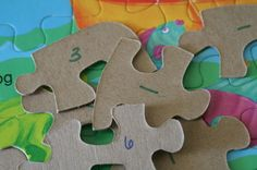 Code your kid's puzzles with a number on the back. Makes clean up much easier if the pieces get mixed up.
