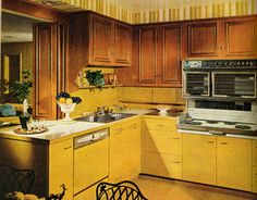 The cabinets are done in antiqued cherry with colorful base units. Featured in the March 1966 issue.   - HouseBeautiful.com