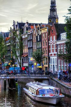 Amsterdam Canals, Netherlands  The boat ride was a wonderful way to see the city at night!