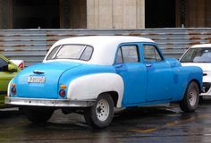 Late 40s with spectacular 2 tone on the fenders. Probably a Plymouth or Dodge