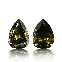 #Chameleon, #Diamonds, #Pair, #Earrings, #Green, #Reddiam A gorgeous and rare natural chameleon diamond pair. 1.21ct fancy dark gray yellowish green SI1 and 1.19ct fancy deep grayish yellowish green pear shaped diamonds. Both eye clean and GIA certified natural with striking natural color. This pair will make an amazing earring pair will look great with white diamonds. Retail value is over 20k per cara