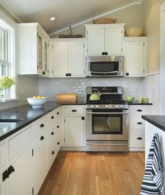 Lovely Kitchen, Fresh L Shaped Kitchen Design White Cabinets  Hardwood Laminate Floor White Sleek Subway Tile Backsplash Freestanding Oven Stove White Freestanding Kitchen Cabinet Black Granite Glass Countertop Best Small Kitchen Ideas: Modern And Small Kitchen Remodel With Freestanding Kitchen Cabinet