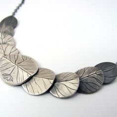 articulated lily pads necklace hand engraved