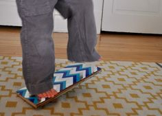 balance board- scrap wood, dowel or PVC, decorated with duct tape or paint mixed with sand (for traction)