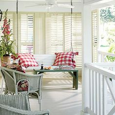 The porch swing just might be the best room in the house. This one is dressed in red gingham pillows. Coastalliving.com