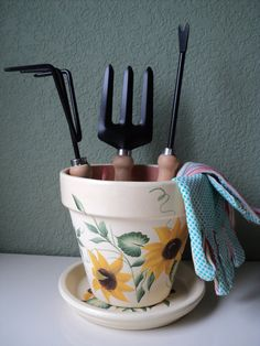 ***HERES A GREAT GIFT IDEA FOR YOUR FAVORITE HOSTESS, OR FOR THAT SPECIAL GARDENER IN YOUR LIFE***  *PLEASE NOTE: GARDEN TOOLS IN PICTURE #5 DEPICTS SUGGESTED USE ONLY, GARDEN TOOLS ARE NOT INCLUDED*  This clay flower pot & matching saucer are hand painted by me, in bright and durable acrylics. The background color is a subtle french vanilla; The sunflower petals have shades of both a brighter & a darker yellow; the flower centers are shaded with black & brown. This design is free...