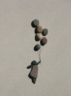 How cute is this adorable pebble art? Something fun you can make with the kids while you're outside for a few minutes (seems like I am always waiting for someone, and you can let the kids look around for sticks and rocks - they will get a kick out of making this).