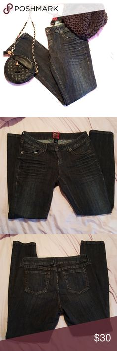 Torrid Dark Wash Skinny Jeans In excellent used condition Torrid dark wash distressed skinny jeans. Barely worn. Has a ripple design on front of thighs and little bits of distress throughout. Perfect color to dress up or down. Torrid Jeans Skinny