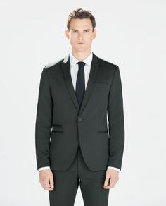 One button peak lapel jetted pocket black suit